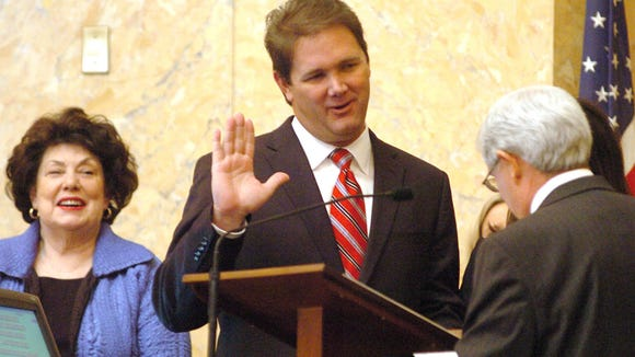 Newest House of Representatives member, Scott DeLano, R-Biloxi, is sworn during the opening day of the 2010 Legislative Session at the state Capitol Tuesday. Rep. Diane Peranich, D-Pass Christian (left) watches the proceedings.