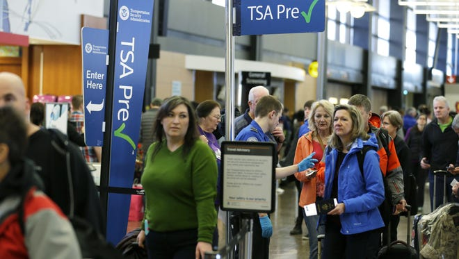 Travelers authorized to use the Transportation Security Administration's PreCheck expedited security line at Seattle-Tacoma International Airport have their documents checked in March.