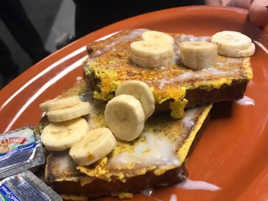 Banana bread French toast with fresh bananas and icing