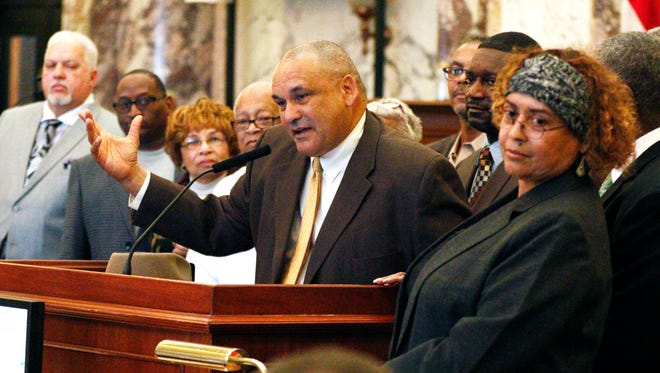 Dennis Dahmer, son of Vernon Dahmer Sr., a civil rights leader killed 50 years ago when Ku Klux Klansmen firebombed his family's home and businesses near Hattiesburg, addresses the Mississippi Legislature in the Senate chamber Friday at the Capitol in Jackson. The ceremony is the latest in a long effort by Mississippi officials to recognize the troubled racial history of a state that still displays the Confederate battle emblem on its flag.