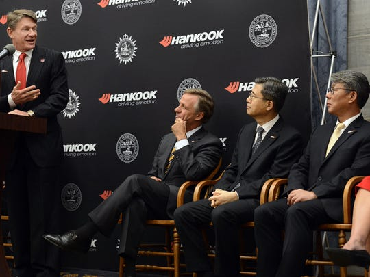 Tennessee Economic and Community Development Commissioner Randy Boyd speaks to Gov. Bill Haslam, Hankook Vice Chairman and CEO S.H. John Suh and Hankook Tire America Corp. President Hee Se Ahn at a news conference at the state Capitol building on April 13, 2016, in Nashville.