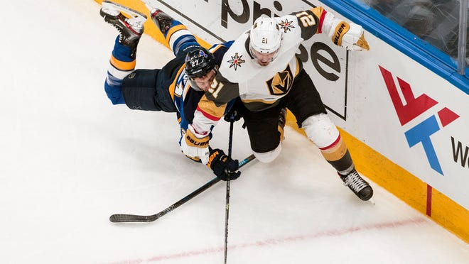 St. Louis Blues' Alex Pietrangelo (27) and Vegas Golden Knights' Nick Cousins (21) battle for the puck during the second period of an NHL hockey playoff game Thursday, Aug. 6, 2020, in Edmonton, Alberta.