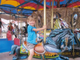 Nathaniel riding a carousel.