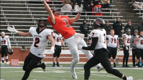 Hope's Cooper Cecchini (center) attempts to make a catch during Hope's loss to Wartburg on Nov. 23, 2019.