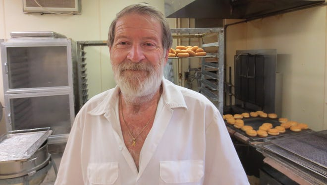 Lou King is back in the kitchen at Donut King, his 42-year-old West Des Moines  business he shut down for six weeks while he recuperated from a broken hip.