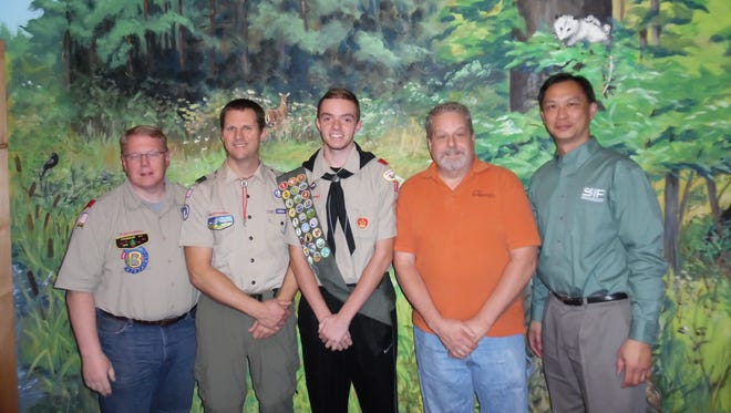 Stephen Seltzer, center, with his Eagle Scout Review Board.