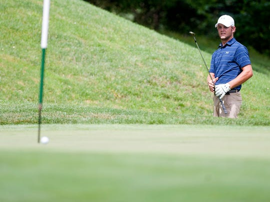 Alex Rainville watches his third shot roll toward the cup at the par-5 16th hole during the first round of the Vermont Amateur on Tuesday at Dorset Field Club.
