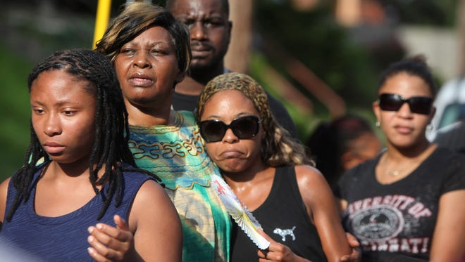 Audrey Dubose comforts family and friends at the vigil. ÒIt was unjustified. My son had no business getting killed,Ó she told the press after the event.
