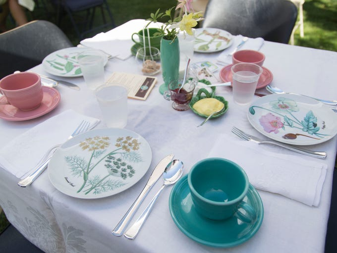 Tables were set up for tea on the lawn of the historic
