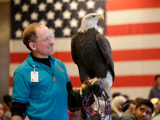 Schlitz Audubon raptor volunteer Ken Wardius holds a bald eagle for students to see. Groups of kids from area Milwaukee Public Schools visited the Milwaukee County War Memorial, 750 N Lincoln Memorial Drive,  Feb. 13, 2017,  for a program featuring raptors from the Schlitz Audubon and a Civil War re-enactor talking about daily life for the common solder in the 8th Wisconsin Volunteer Infantry Regiment.