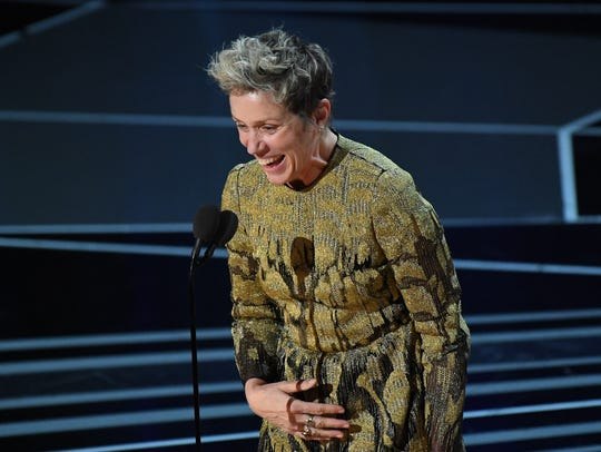 Frances McDormand accepts the Oscar.