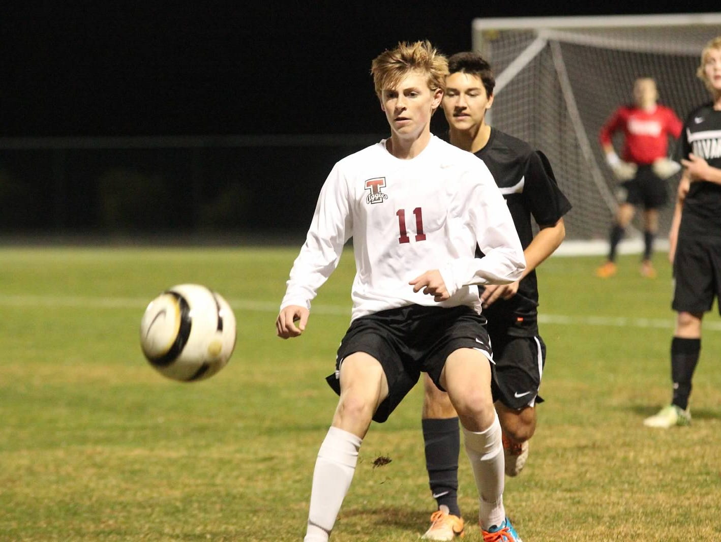L.J. Estes (No. 11) has been pivotal in the hot start (5-0, 4-0) for the Tate Aggies boys soccer team this season.
