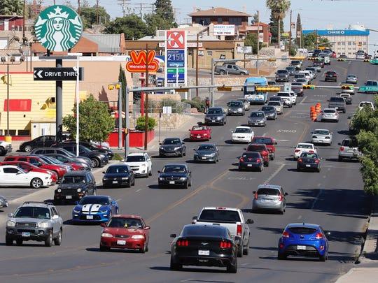 Traffic flows along North Mesa Street at 4:50 p.m. Tuesday near the University of Texas at El Paso.