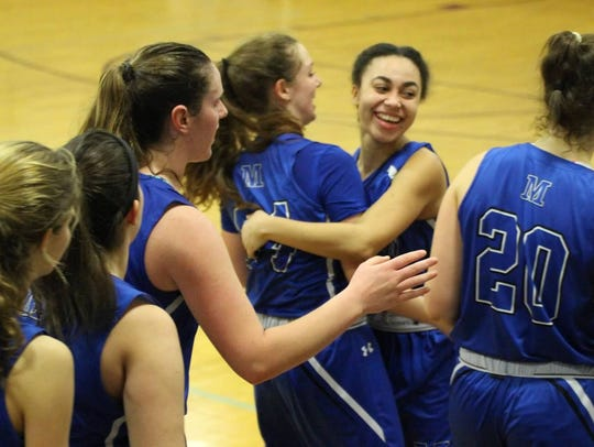 Players embrace as Millburn girls basketball upsets Bayonne, 41-37, to reach the sectional semifinal for the first time ever.