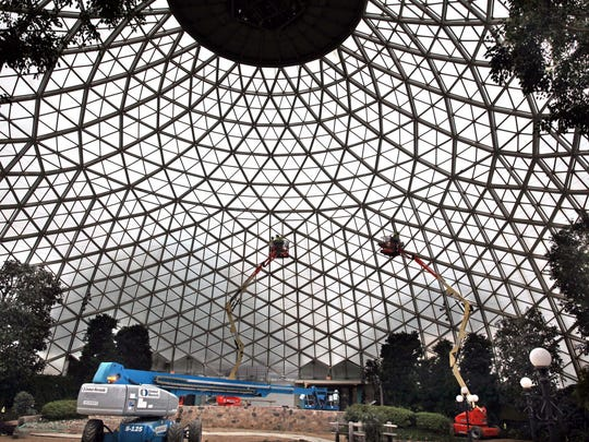 Workers install stainless steel mesh inside the Show