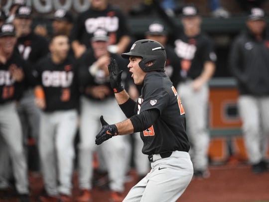 OSU's Jack Anderson celebrates after hitting a home