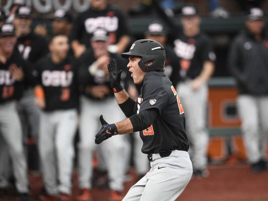 OSU's Jack Anderson celebrates after hitting a home run against Yale in the Corvallis Regional at Goss Stadium on June 3, 2017