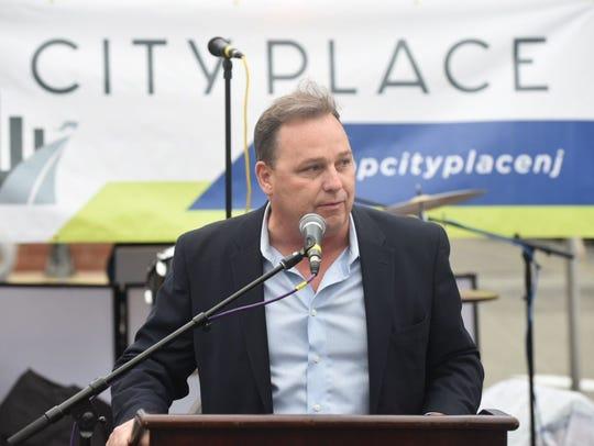 Edgewater Mayor Michael McPartland welcomes everyone