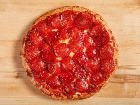 The picture is of a Pizza Factory hand-tossed pepperoni