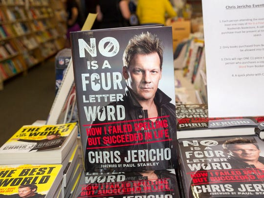 "WWE superstar Chris Jericho singed copies of his new book ""No Is A Four Letter Word."""
