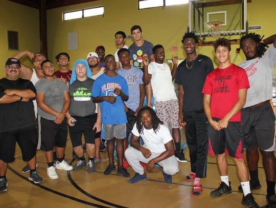 The Immokalee High School football team helped package
