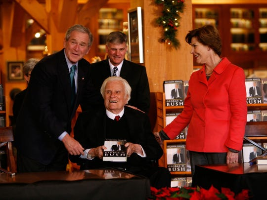 The Rev. Billy Graham has counseled a dozen presidents over his career, including George W. Bush, here with his wife, Laura, and Graham's son, Franklin.