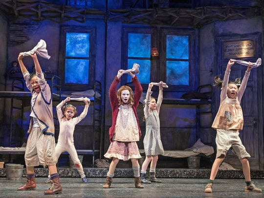 """From left, Michelle Henderson, Tessa Noelle Frascogna, Cassidy Pry, Eve Johnson and Laurie Sun perform """"It's the Hard-Knock Life"""" at the Paper Mill Playhouse."""