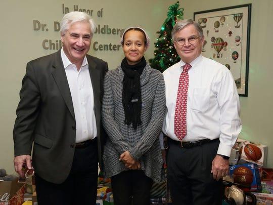Anthony D'Urso, at left, a Montclair State University professor who co-directs Finding Words, a forensic interviewing academy, and who is co-director of the Audrey Hepburn Children's House, here with Paulett Diah, the house's co-director, and Stephen Percy, the interim chair, in 2017.