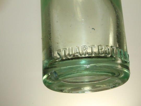 Close-up of the bottom of the Stuart Bottling Co.