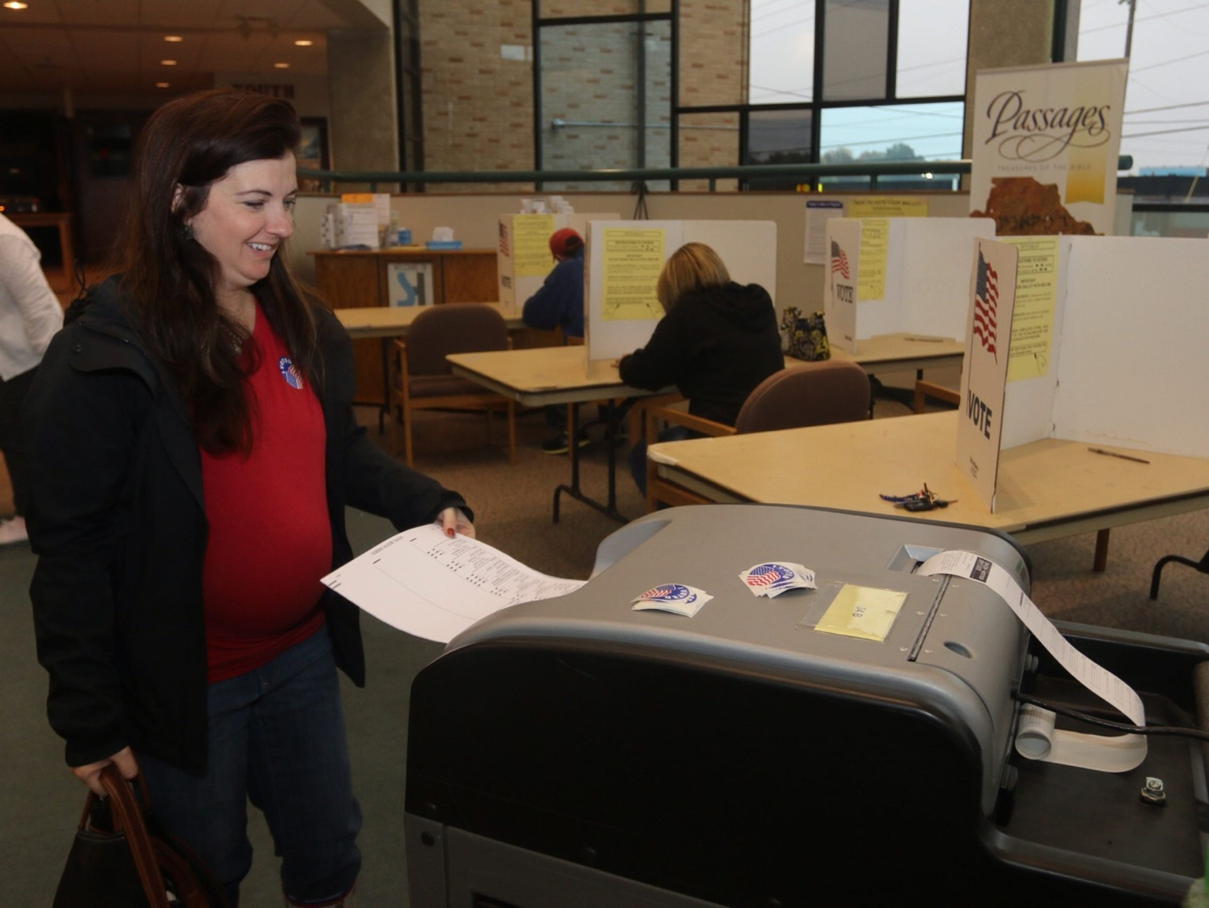 Amber Knight inserts her ballot while voting at the