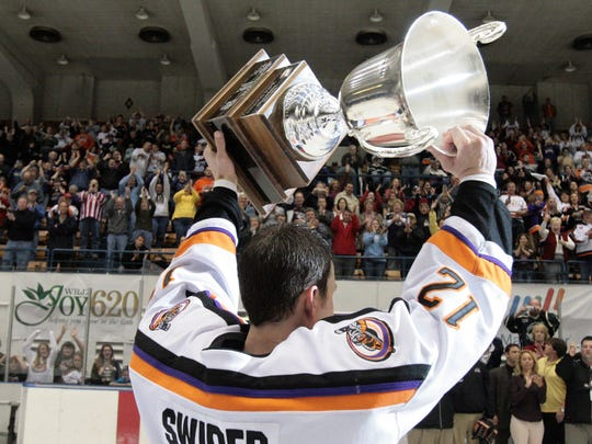 Knoxville's Kevin Swider holds up the President's Cup trophy after the team beat Jacksonville for the title.
