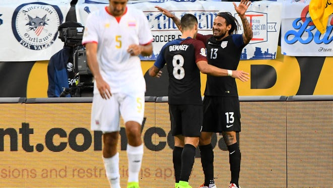U.S. midfielder Jermaine Jones, right, celebrates with Clint Dempsey after scoring a goal against Costa Rica.