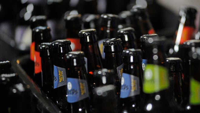 Beer awaits consumption at the Manitowoc County Expo Grounds for 19th annual Jaycees Beer Lovers Brewfest on Saturday, Feb. 21, 2015, at the Manitowoc Expo Grounds in Manitowoc.  Matthew Apgar/HTR Media