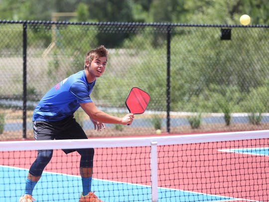 Ben Johns, U.S. Open Pickleball gold medalist, plays one of the opening games at the Bonita Springs YMCA courts.