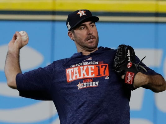 Houston Astros' Justin Verlander warms up before Game 1 of the American League Championship Series baseball game against the New York Yankees Friday, Oct. 13, 2017, in Houston. (AP Photo/David J. Phillip)