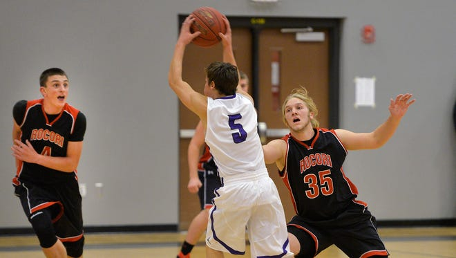 Little Falls' Austin Weisz (5) looks for a way out of coverage from Rocori's Connor Schoborg (4) and Austin Overman (35) in the first half.