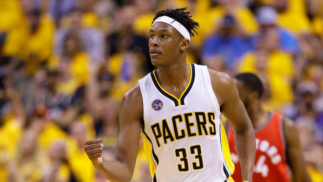 Indiana Pacers forward Myles Turner (33) reacts to the team's play on the court during the second half of Game 6 in an NBA  playoff game  Friday, April 29, 2016, at Bankers Life Fieldhouse. The Pacers won 101-83.