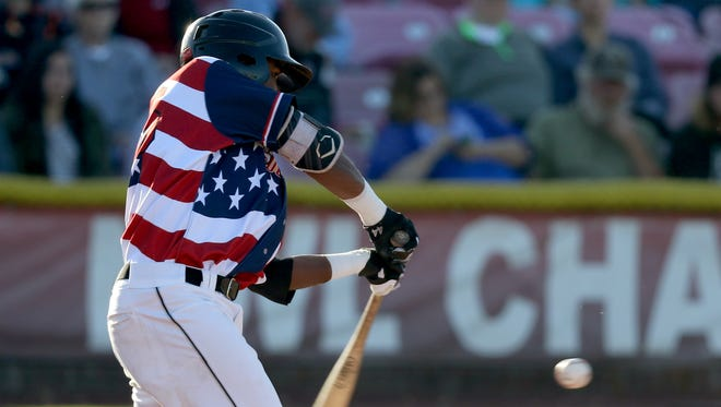 The Volcanoes' Manuel Geraldo (26) bats in the Salem-Keizer Volcanoes vs. Vancouver Canadians baseball game in Keizer on Monday, July 4, 2016.