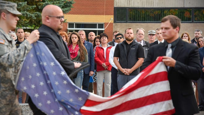 The American flag was unfolded and prepared to be raised during a Patriot Day ceremony and observance of 9/11 Monday, Sept. 11, at St. Cloud State University.