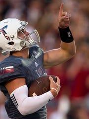 Troy quarterback Kaleb Barker (7) runs for a touchdown