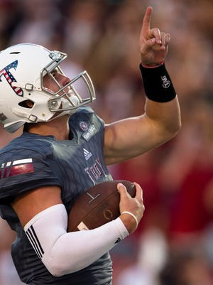 Troy quarterback Kaleb Barker (7) runs for a touchdown during NCAA football game between Troy and Akron on Saturday, Sept. 23, 2017, in Troy, Ala.