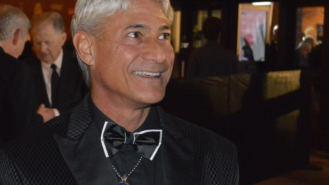 """Olympic diver Greg Louganis is seen Saturday, Jan. 3, 3015, on the red carpet at the Palm Springs International Film Festival at the Palm Springs Convention Center. He's the subject of the documentary, """"Back on Board: Greg Louganis,"""" that is playing at the 26th annual festival."""