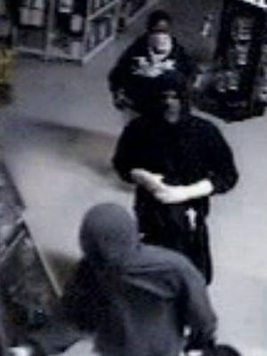 A surveillance image from Sharonville's Target World where 50 firearms were stolen Sunday, according to police