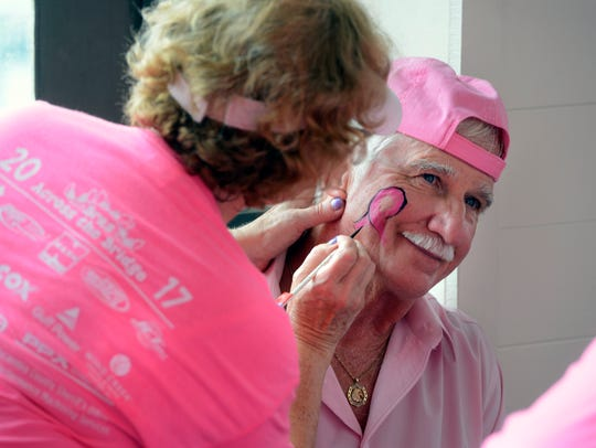 Owl Lample gets his face painted with a pink ribbon during the eighth annual Bras Across the Bridge at The Grand Marlin.