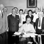 In this Aug. 14, 1935, file photo, President Franklin Roosevelt signs the Social Security Bill in Washington. The massive retirement and disability program is feeling its age. Social Security's disability fund is projected to run dry next year. The retirement fund has enough money to pay full benefits until 2035.