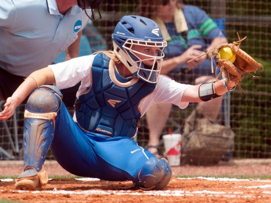 University of West Florida catcher, Caitlin Steel, holds the ball in place and waits for the strike call during Thursday's first round NCAA South Region game against Claflin University.