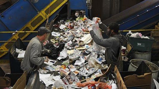 Frank Hansell, left, and Lester Simmons, right, both sorters at Millennium Recycling, sort items on a conveyor belt Tuesday, March 22, 2016, at Millennium Recycling in Sioux Falls.
