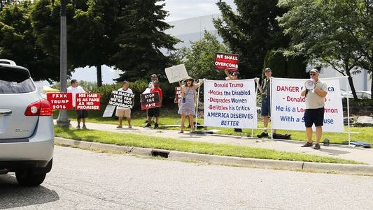 A small group of protestors are gathered outside of The Summit in Dimondale before GOP Presidential candidate Donald Trump's rally in Dimondale, Friday, Aug. 19, 2016.