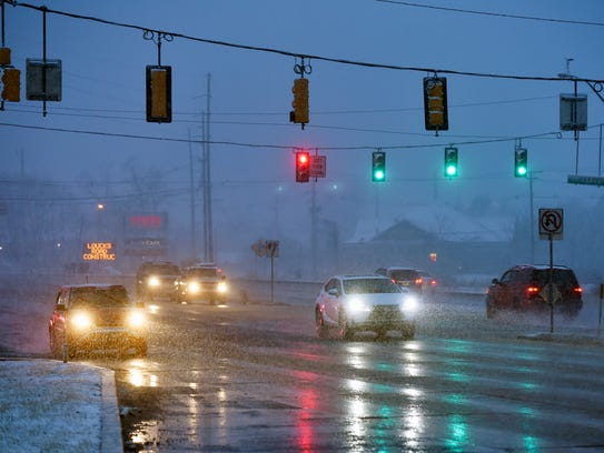 Traffic continues on U.S. 30 during a winter weather