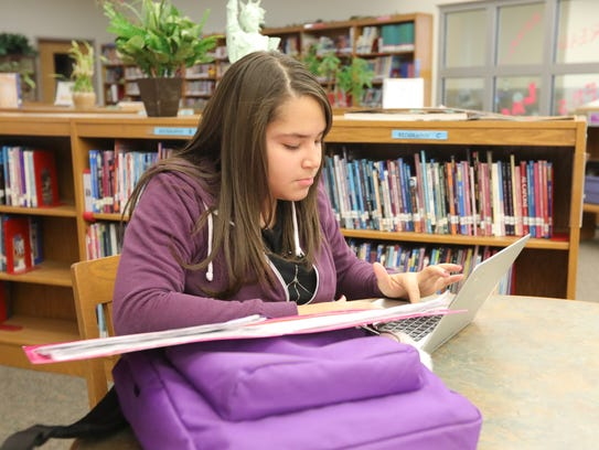 Kimberly Ridtiguez-Orena works in the library at Fieldstone